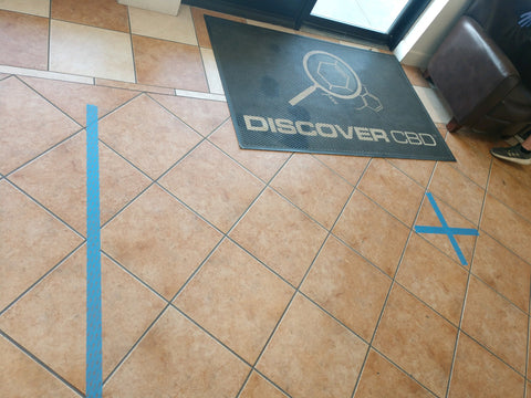 Blue lines on store floor to represent safe distance