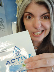 woman making silly face holding package close to camera