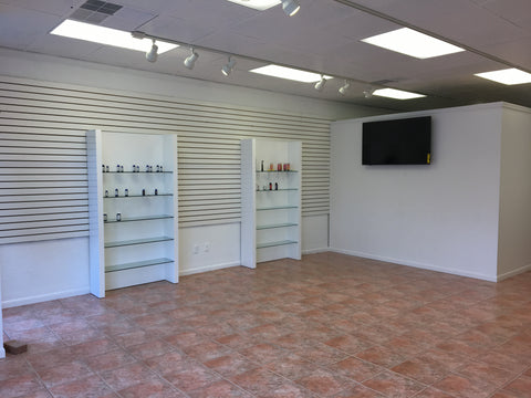 Inside of store building with tv and shelving