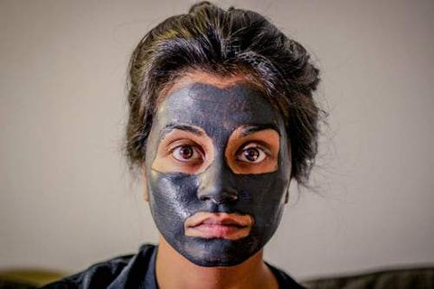woman wearing cosmetic mask on face