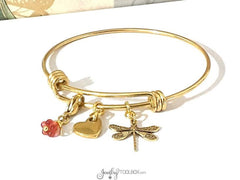 Gold bangle bracelet with gold dragonfly charm