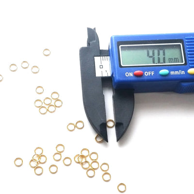 Gold Stainless Jump Rings, 4x0.6mm, 2.8mm Inside Diameter, 23 gauge, Closed Unsoldered, Lot Size 100