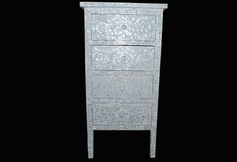 Mother of pearl inlaid chest of drawers.