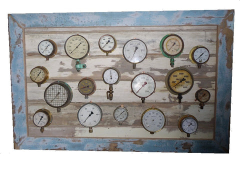 Industrial montage of vintage pressure guages.