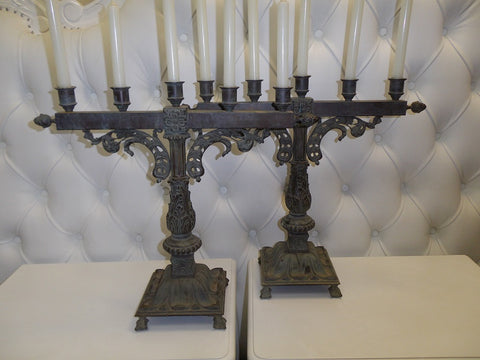 Pair of decorative antique bronze candle sticks.