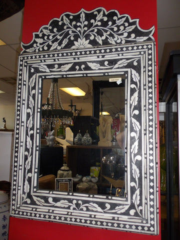 Decorative bone inlaid mirror.