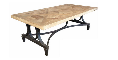 Industrial style coffee table on iron base.