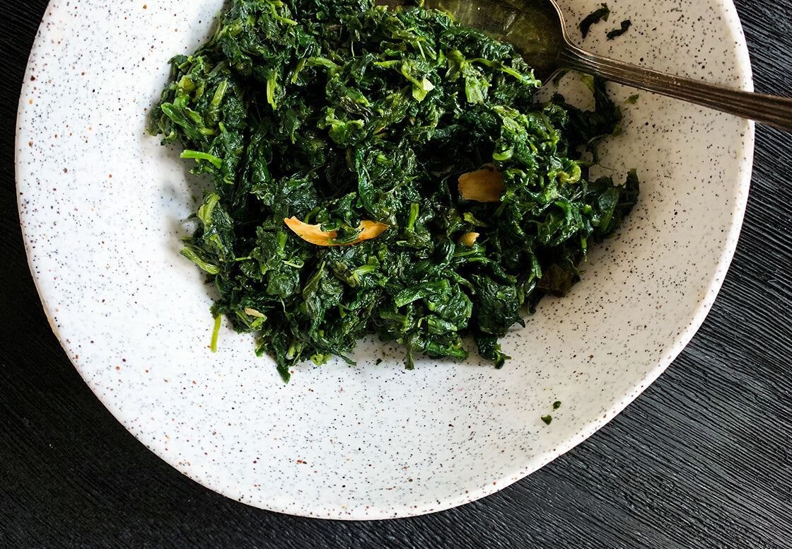A simple vegetarian/ vegan recipe for roasted spinach infused with bold flavours of garlic and chilli. Simple Indian recipe, can be eaten as a main, with daal or curry, roasted potatoes or filled into puffs. versatile easy everyday food from indian goods co.