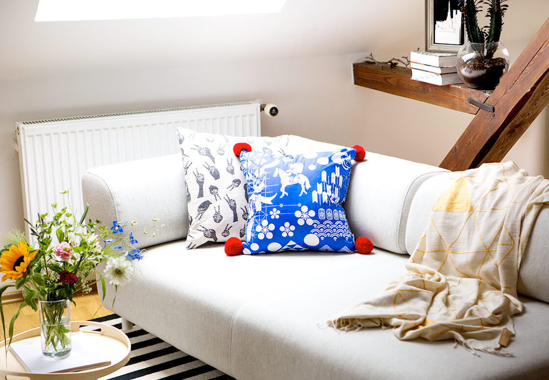 indiangoodsco_blog article_ten_things_welcoming_spring_living room fresh colourful cushions throw