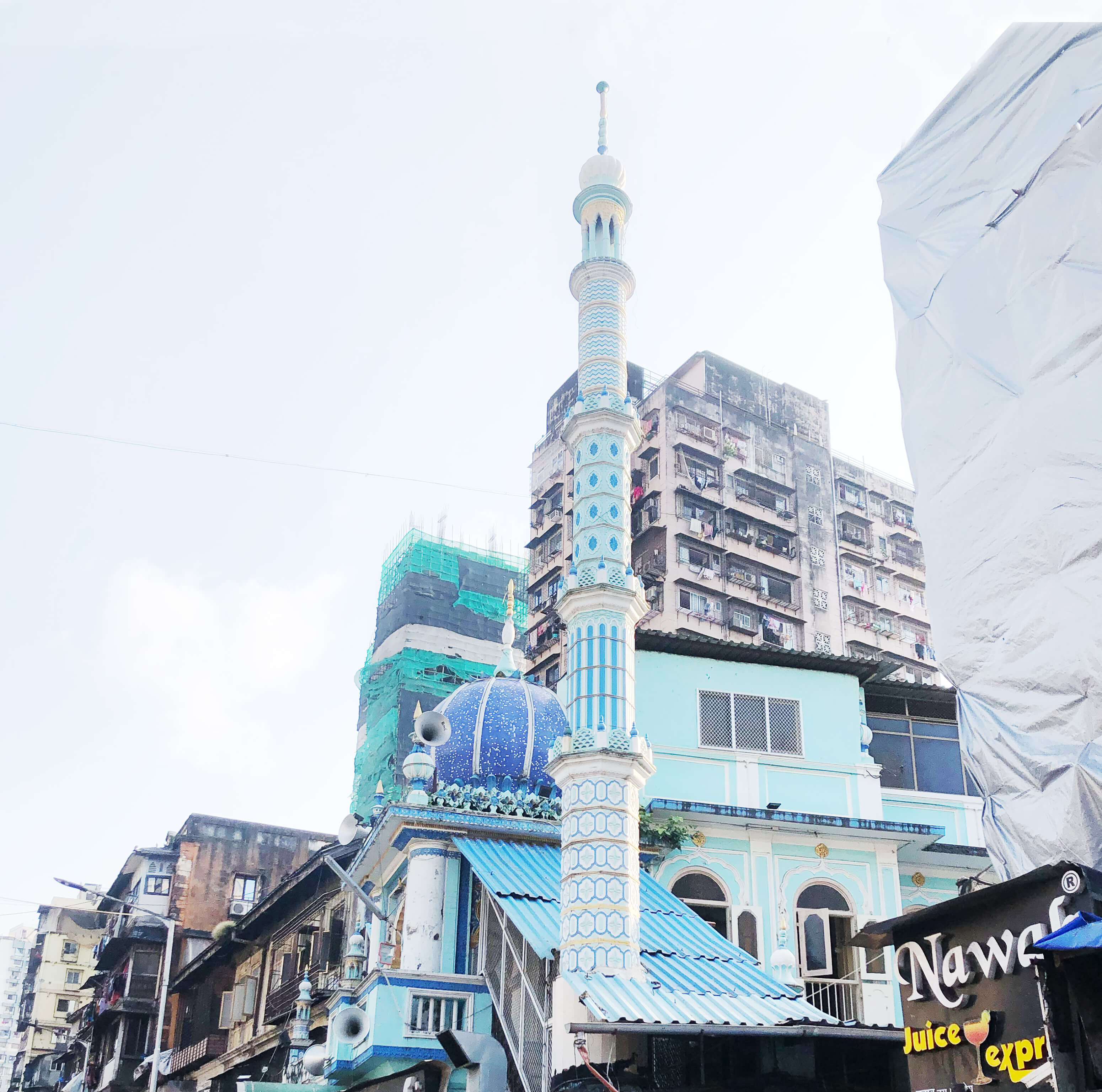 A blue mosque in Mohammed Ali Road market in South Mumbai surrounded by residential high rise buildings