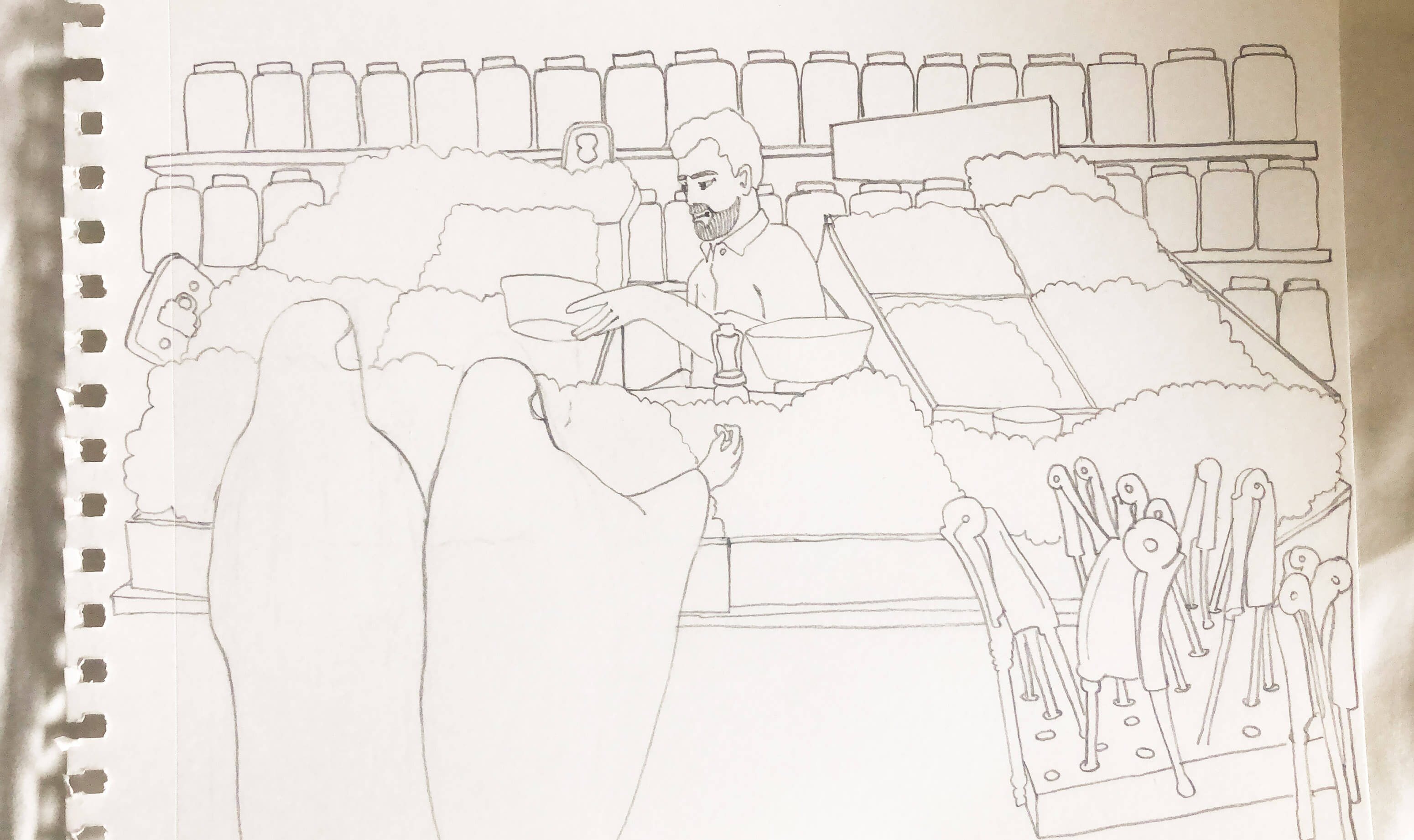 Pencil sketch on white paper of an Indian male vendor dried fruits and other dry goods in his store in Mumbai