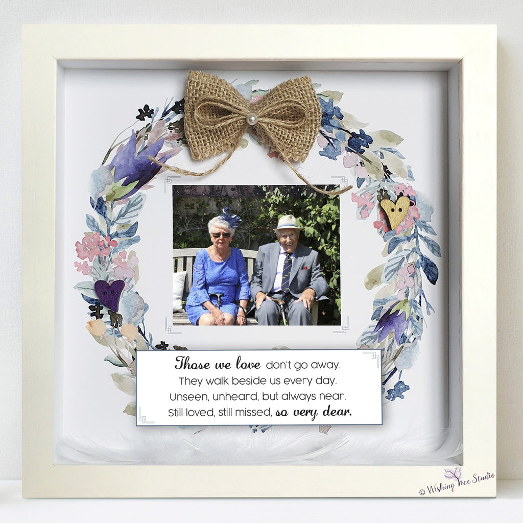 Memorial photo frame with feathers