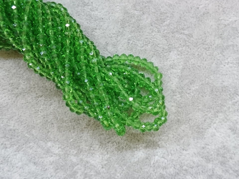 3x4mm faceted rondelle glass beads, Transparent Medium Green (#15) - amakeit bead 天富