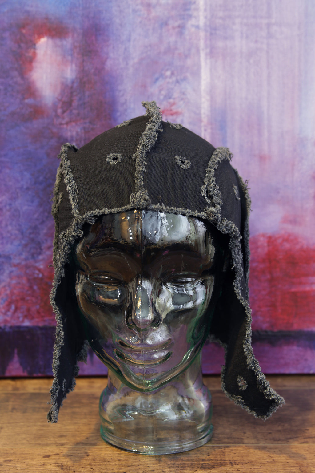 black artifacted bonnet / helmet / hat from secret lentil