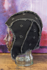 black artifacted bonnet / helmet / hat