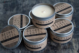 secret lentil soy wax candles in lidded metal tins