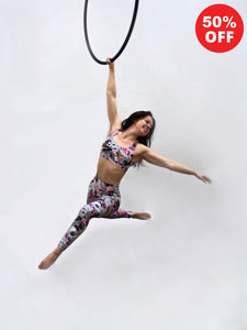 Aerial hoop artist wearing Flip the Dog pink butterfly and floral print leggings and bra top