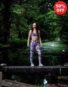 Woman wearing Flip the Dog pink butterfly print fitness wear leggings and bra top on a canal lock