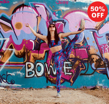 Load image into Gallery viewer, Woman by graffiti wall wearing pink patterned fitness wear leggings and bra top by Flip the Dog
