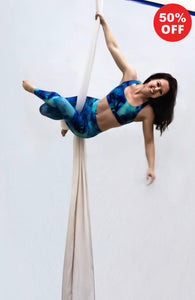 Aerial silk artist wearing turquoise leggings and bra top from Flip the Dog