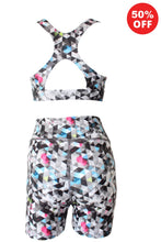 Load image into Gallery viewer, Black and white geometric pattern eco fitness wear shorts and racer back bra top by Flip the Dog