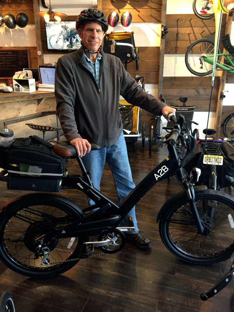 a happy A2B Alva+ e-bike owner