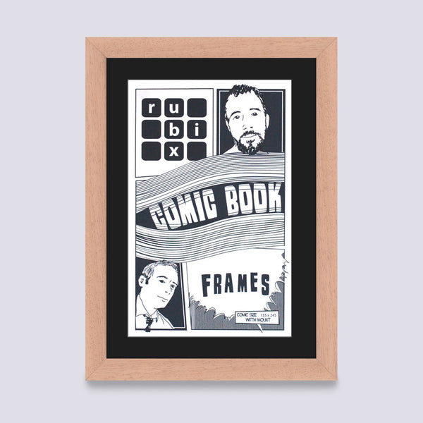 light wood comic book frame with black mount handmade in the UK with wood mouldings