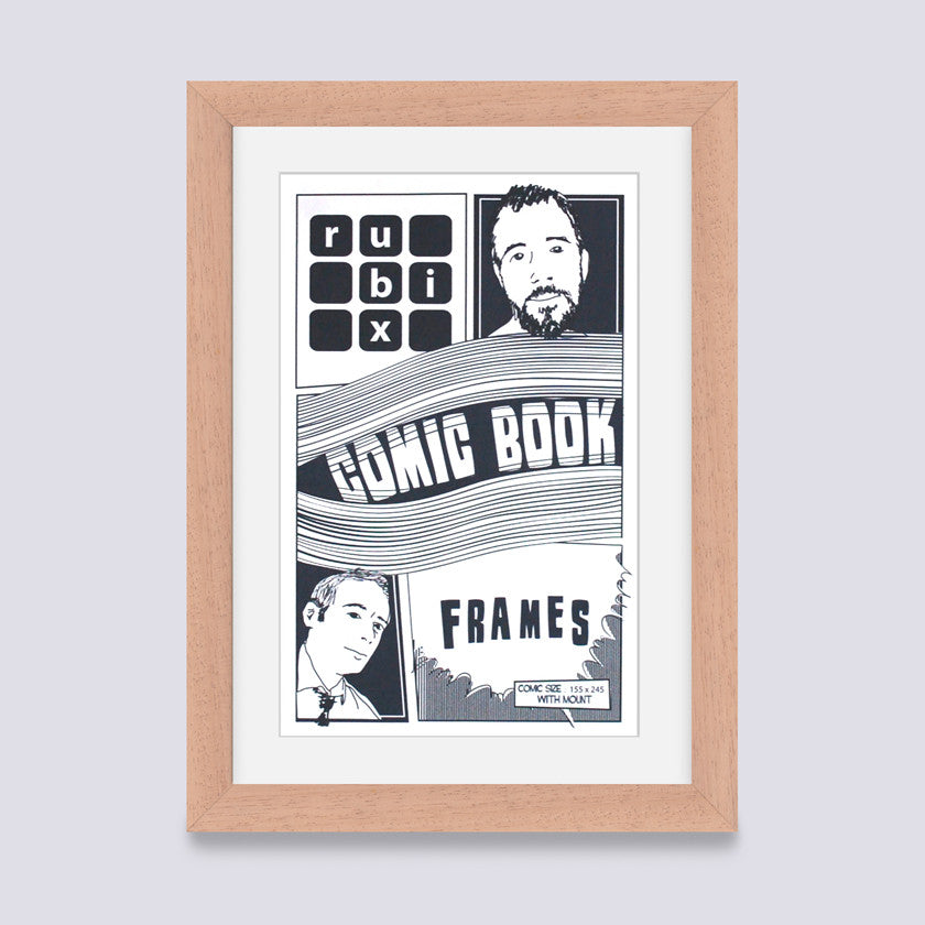 light wood comic book frame with white mount handmade in the UK with wood mouldings