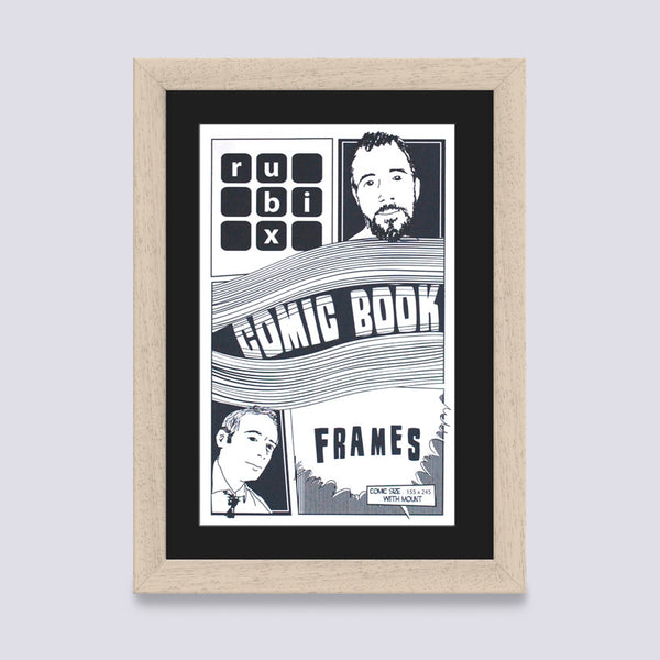 cream comic book frame with black mount handmade from wood mouldings