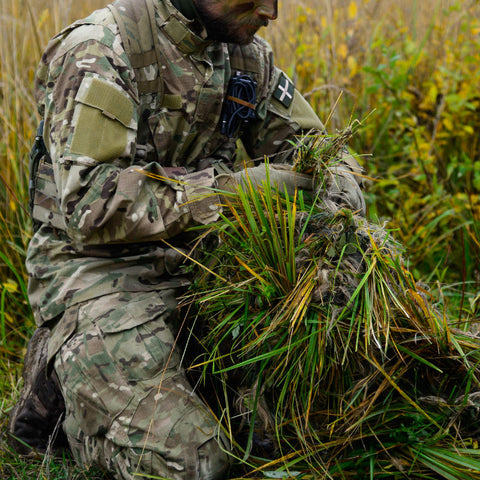 Soldier creating a Ghillie suit
