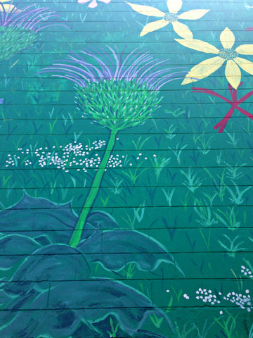 Mural on the side of Thistle Farms in Nashville. ExploreLocalUniverse.com