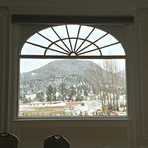 Looking out the window at The Stanley Hotel in Estes Park, inspiration for The Shining, with Local Universe. www.explorelocaluniverse.come