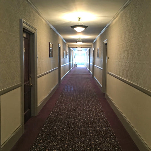 The hallway said to echo with the shouts of children at play at The Stanley Hotel in Estes Park, inspiration for The Shining, with Local Universe. www.explorelocaluniverse.come