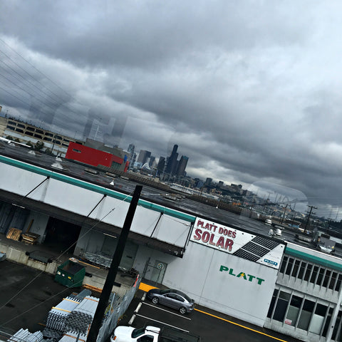 Cloudy Seattle as seen from the train. And somehow there's a solar company...Read the full travel blog and find locally made Seattle goods at www.explorelocaluniverse.com.