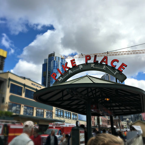 A break in the clouds at the Pike Place Market. Read the full travel blog and find locally made Seattle goods at www.explorelocaluniverse.com.