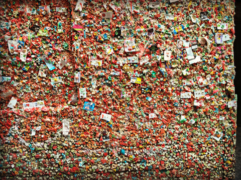The Gum Wall at the Pike Place Market. Read the full travel blog and find locally made Seattle goods at www.explorelocaluniverse.com.
