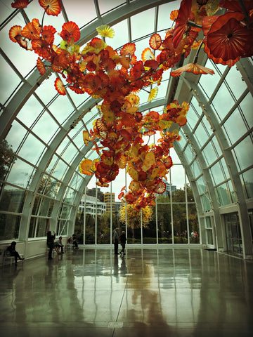 A hall filled with hanging Chihuly glass. Read the full travel blog and find locally made Seattle goods at www.explorelocaluniverse.com.