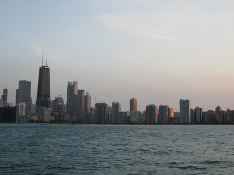 Chicago at sunset from Lake Michigan is a romantic and beautiful sight. www.explorelocaluniverse.com