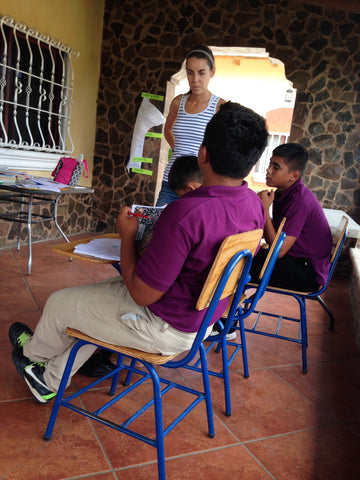 Megan teaching English with Victor, Eduard and Ismael at Micah House, Honduras. ExploreLocalUniverse.com