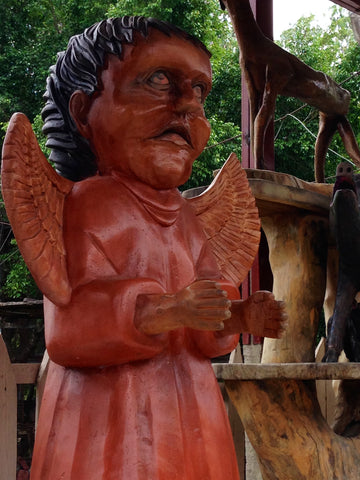 Scary angel statue at zoo in Honduras. ExploreLocalUniverse.com