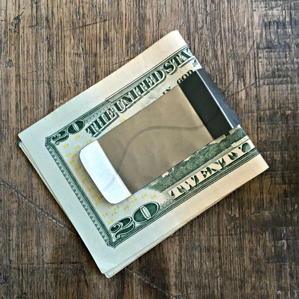 The Cube Money Clip handcrafted of upcycled tin cans in Denver and benefiting Food Bank of the Rockies. www.explorelocaluniverse.com.