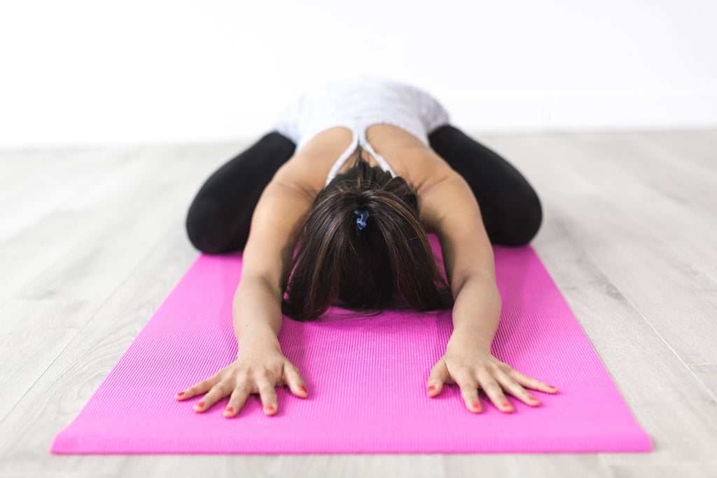 Woman practicing yoga poses
