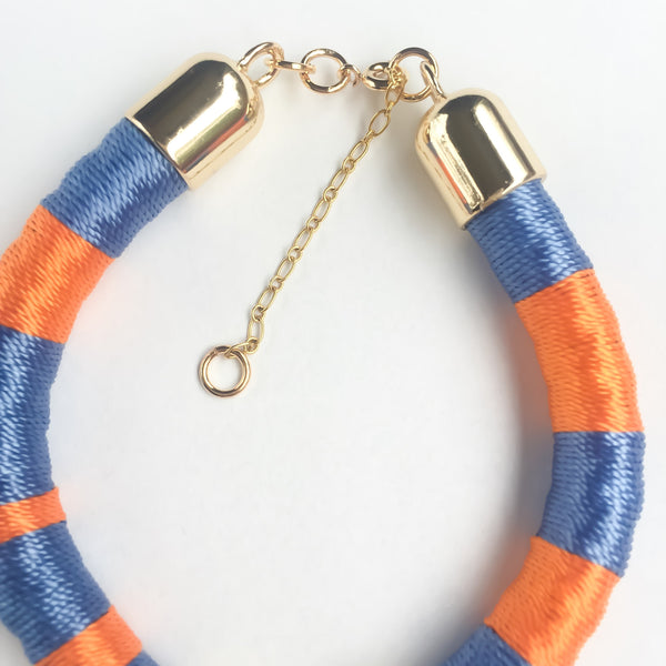 Light blue and orange hand-woven silk satin bracelet with a tassel | KRISTINAGOESWEST.COM - 4