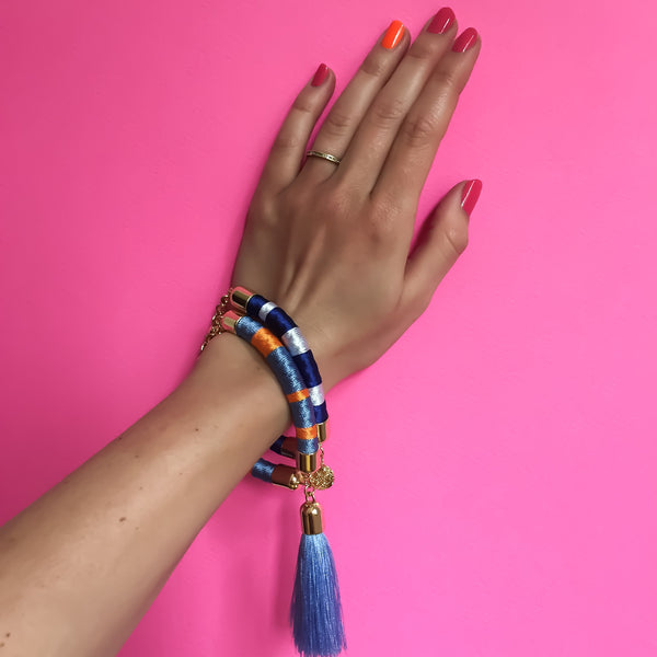 Light blue and orange hand-woven silk satin bracelet with a tassel | KRISTINAGOESWEST.COM - 5