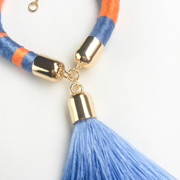 Light blue and orange hand-woven silk satin bracelet with a tassel | KRISTINAGOESWEST.COM - 2