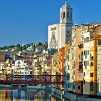Girona River with the colorful buildings and the church in background