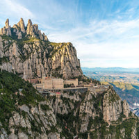 Montserrat in the mountain wall with its buildings and a beautiful blue sky in the background