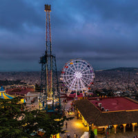 Tibidabo Amusement Park at night with view towards Barcelona