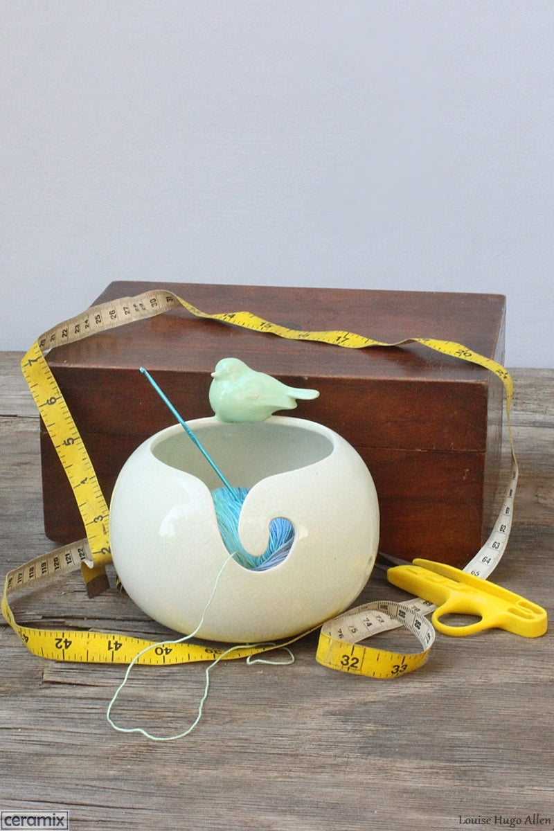 Have a little bird keep you company while you knit by getting the Peaceful Song Green Bird Small Yarn Bowl by Ceramix