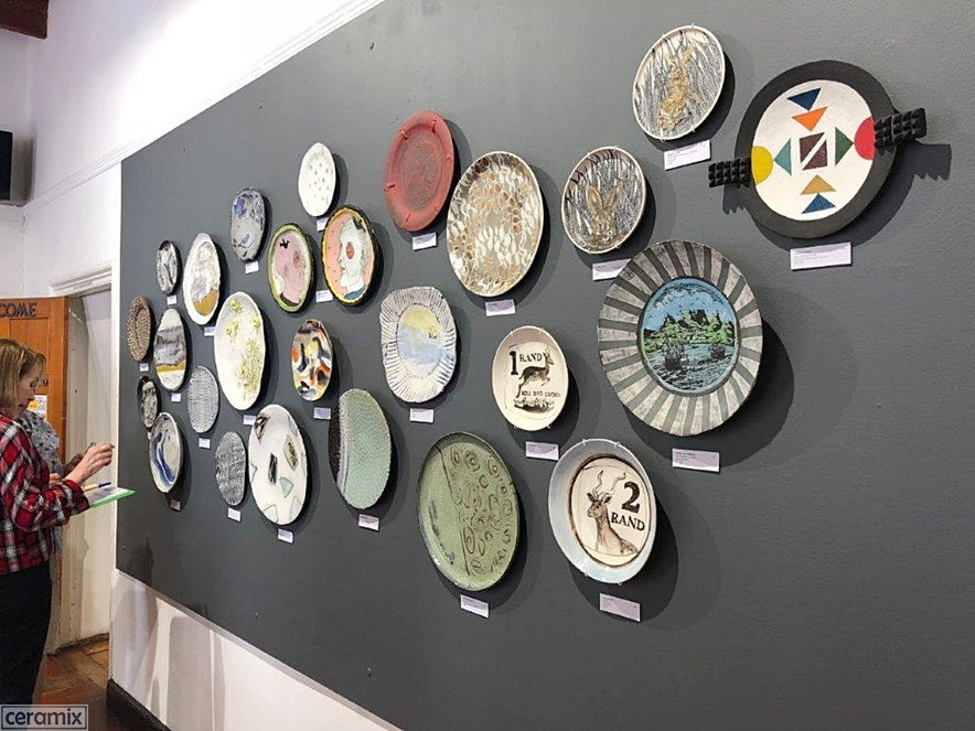 National Ceramics Biennale at Rust-en-Vrede Gallery in Cape Town features a wall of plates
